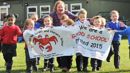 """Head Jackie Bradford and pupils at Suffield Park Infant School celebrate it's""""good"""" rating after the"""