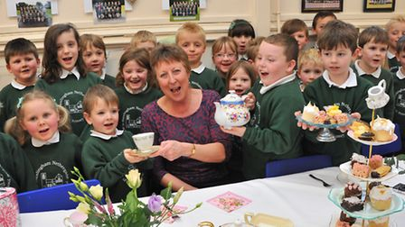 Pupils hold a special tea party for head teacher, Mrs Chris Gibson, who is retiring after 18 years a