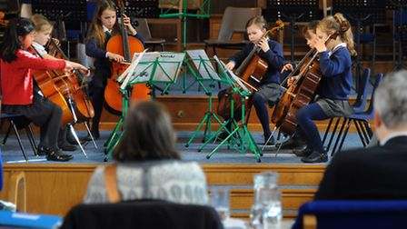 The junior string ensembles playing at the Norfolk County Music Festival 2015. The Mini Cellos group