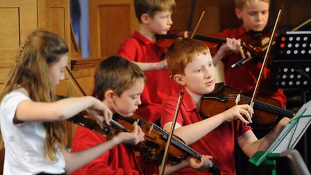 The junior string ensembles playing at the Norfolk County Music Festival 2015. The Brundall Primary