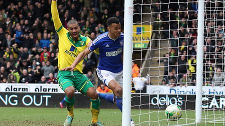 Lewis Grabban bundles home Norwich City's winner in a 2-0 derby day victory over Ipswich. Picture by