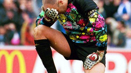 Bryan Gunn holds his heads in his hands after an Ipswich goal.