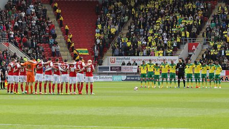 Norwich City and Rotherham players and fans take part in a one minute's silence in memory of those w