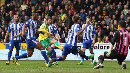 Wes Hoolahan dribbles through the Sheffield Wednesday defence only to see his shot saved by Keiren W