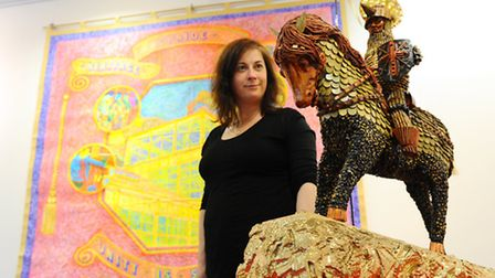 Juliet Hayward with two pieces by Chris Jackson. Exhibition of work at Great Yarmouth Library called