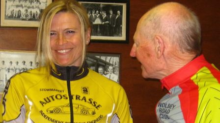Verity Smith receives the Pat Pepper Trophy from Mick Pepper after winning the women's race at the W