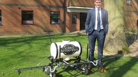Will Jones with the garden sprayer built as part of a design project at Gresham's School