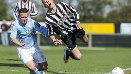 Dereham's Ryan Hawkins feels the full force of a Brentwood challenge. Picture: MATTHEW USHER