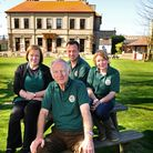 Ken Sims (centre) with three long serving members of staff who are joining Ken and his wife Beryl as