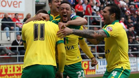 Norwich City players celebrate Gary Hooper's stunning second-half volley in a 1-1 Championship draw