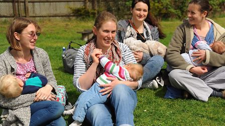 Women breastfeed their children at Woodrow Pilling Park in protest after two women were abused for b