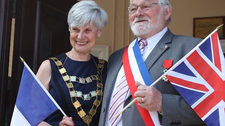 Sheringham mayor Tricia Brooks and her Muzillac counterpart Jo Brohan on the steps of the town hall.