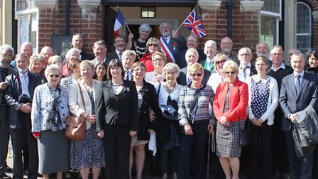 Sheringham twinning association members and their Muzillac counterparts on the steps of the town hal