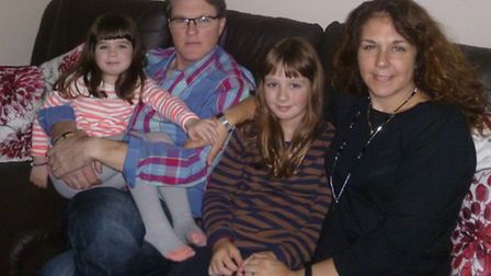 Matt and CassieThomas (nee Jackman) with their daughters Erin, nine, and Lola, five