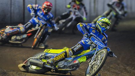 Action from the King's Lynn Stars v Belle Vue - Heat 3 - Kenneth Bjerre leads. Picture: Matthew Ushe