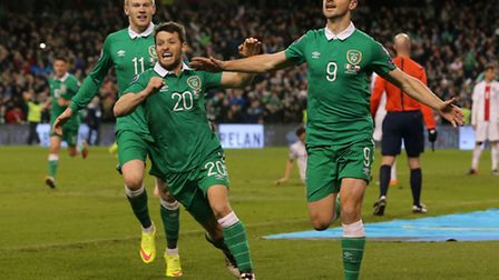 Norwich City midfielder Wes Hoolahan celebrates his dramatic stoppage time assist with Republic of I