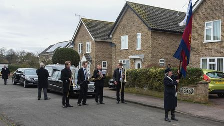 Ron Green's funeral procession taking place in Thetford.