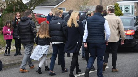 Friends and family following the hearse in Thetford for Ron Green's funeral.
