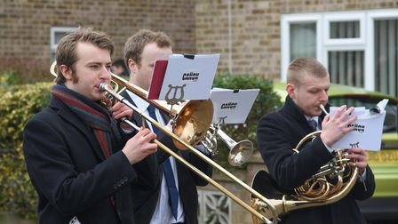 A brass band playing a Salvation Army hymn during Ron Green's funeral procession in Thetford. Pictur