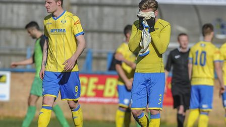 Action from King's Lynn Town v Barwell at The Walks - Jake Jones covers his face after the final whi