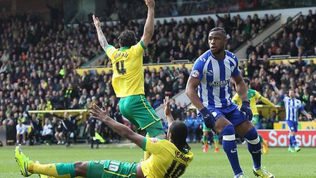 Bradley Johnson and Cameron Jerome appeal for a first half penalty in Norwich City's 2-0 Easter Mond