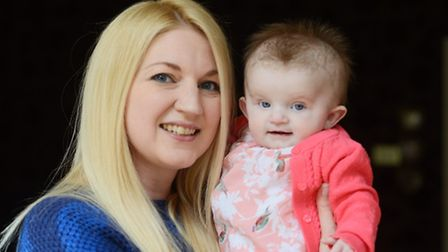 Zoe Bradshaw with her 6 month-old daughter Amy. Picture: Ian Burt