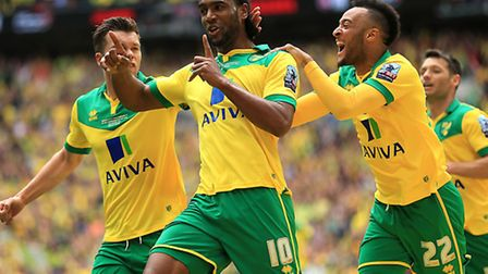 Norwich City's Cameron Jerome (centre) celebrates scoring his side's first goal of the game during t