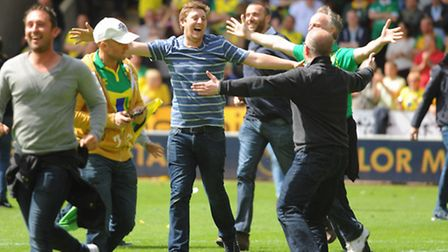 Norwich City V Ipswich Town derby play-off at Carrow Road. Norwich City fans invade the pitch at ful