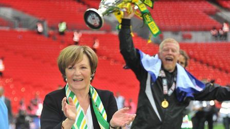 Delia Smith applauds the Norwich City fans with a jubilant Gary Holt in the background. Picture: Sim