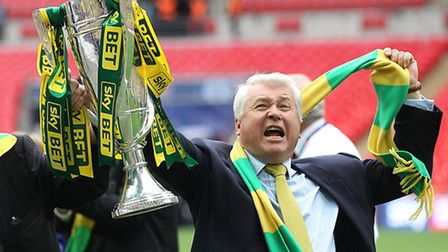 Norwich City chairman Alan Bowkett celebrates with the Championship play-off trophy. Picture: Paul C