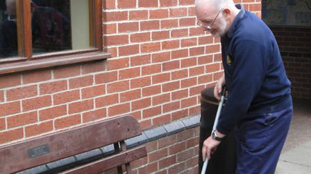Andrew Tunwell, facilities manager of the Bure Valley Railway, cleaning up glass outside the Aylsham