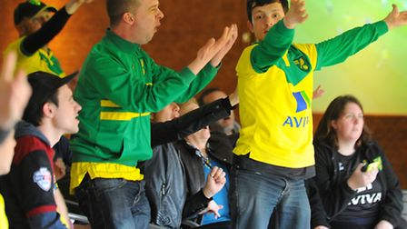 Norwich City Football Club fans in the Top of the Terrace, Carrow Road watching the first leg of the