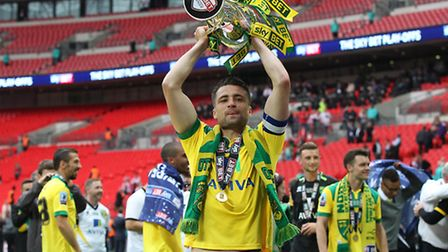 Russell Martin with the trophy at the end of the Championship play-off final at Wembley Stadium. Pic