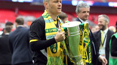 Alex Neil secured his second consecutive promotion in 12 months by leading Norwich City back to the