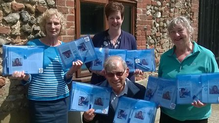 Susan Brand (standing centre) and Alzheimer's Society volunteers (from left) Barbara Alexander, Coli