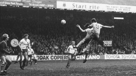 John Deehan scores a goal against Watford during a 6-1 win for Norwich City at Carrow Road in 1984.
