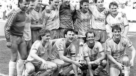 NCFC Division Two champions with trophy in 1986. Back (left to right) Dale Gordon, David Williams, P