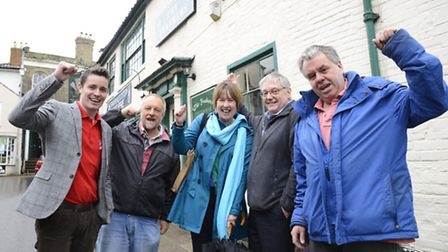 Members of the North Walsham Heritage Centre committee outside the Feather Pub in the town has bough