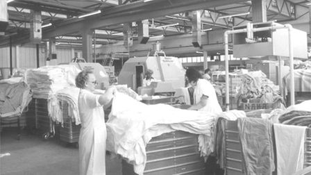 Acres of bedlinen have to be folded and processed in the laundry at the West Norwich Hospital in lat