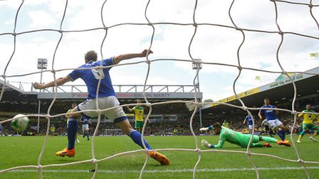 Ipswich defender Christophe Berra is red-carded after handling Nathan Redmond's shot to concede a pe