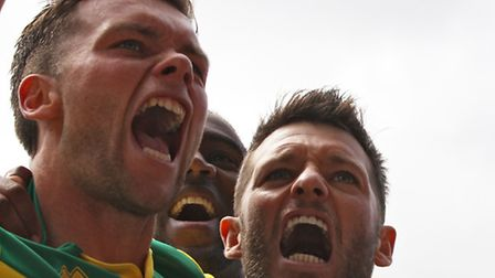 Wes Hoolahan and Jonny Howson celebrate Norwich City's first goal in Saturday's 3-1 Championship pla