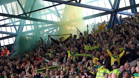 Norwich City fans at Portman Road celebrate taking the lead against Ipswich Town. Picture: Paul Che