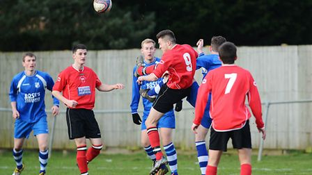 Downham Town, red, can look forward to focusing their efforts towards on-pitch matters next season.