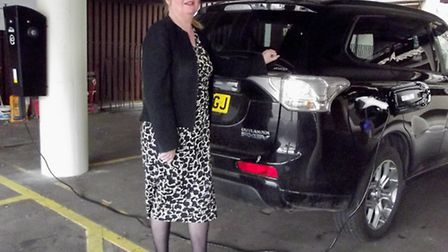 Maids Head general manager Christine Malcolm charges her hybrid car