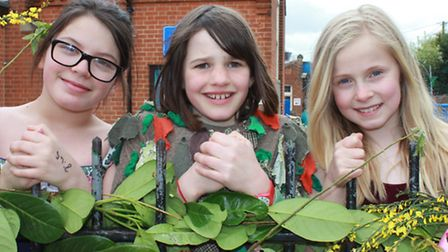 """Corpusty Primary """"May Queens"""" Mille Morris, Betty Booker and Lucy Phelps looking over the school gat"""