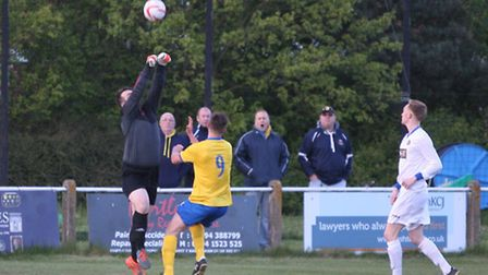 Great Yarmouth Town gaolie saves another close shot on target Gt Yarmouth (in white) playing AFC Sud