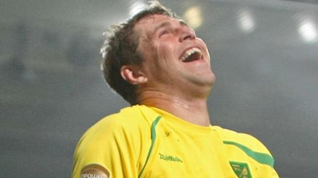 Grant Holt enjoys himself during a Norwich City win over Ipswich Town.