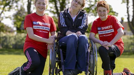 Paralympic World Champion Swimmer Fran Williamson (centre) with sports leaders Rebecca Hollands and