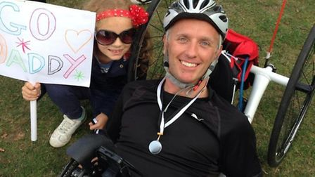 Mike Dawson, from Norwich, with his daughter Abigail, nine, at the end of the Cambridge to Norwich b