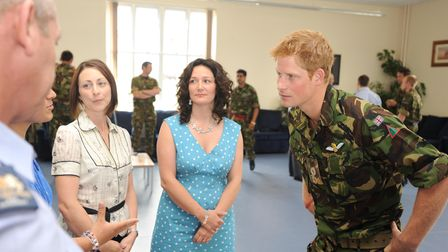 Pictures from Prince Harry's visit to RAF Honington. Speaking to women who have partners in operati